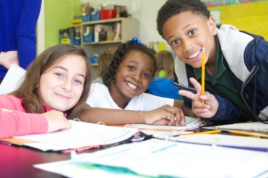 three kids at school smiling