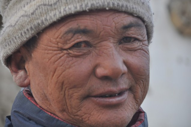 Asian man with wrinkles smiles
