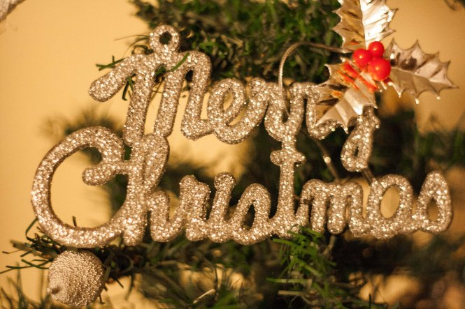 ornament on a christmas tree that says merry christmas